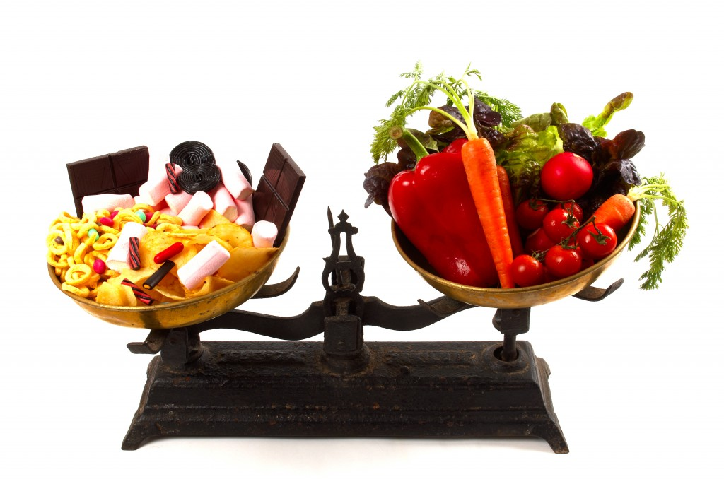 Junk-food-and-veggies-on-scale